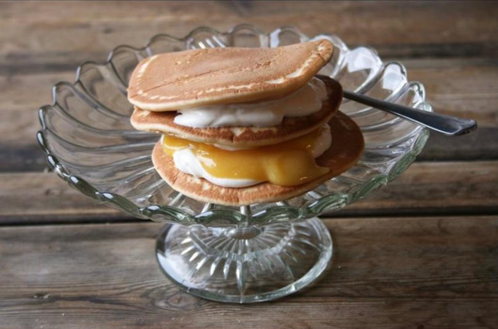 Pancakes for Shrove Tuesday topped with passionfruit & lemon curd and creme fraiche